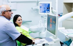Dentist-near-Vermont-South-Dr-Sachdeva-with-patient